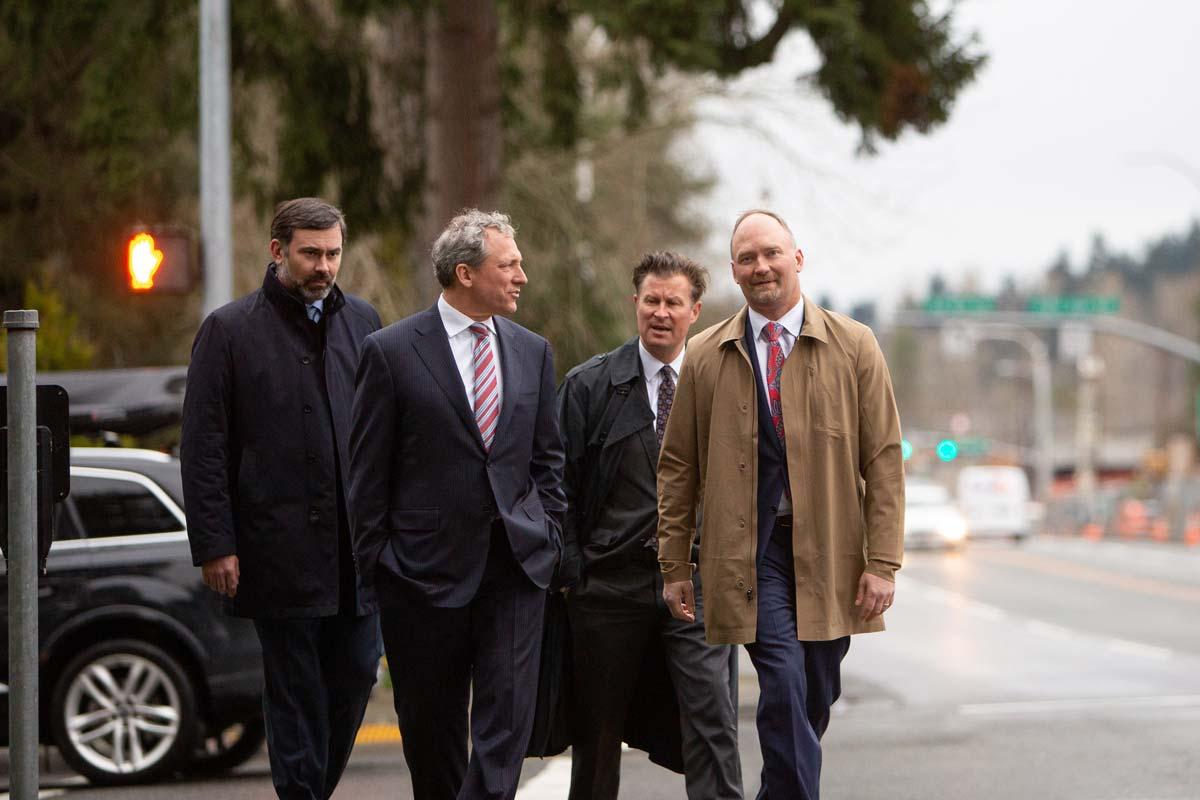 Photo of attorneys Jason Amala, Michael Pfau, Thomas Vertetis, and Darrell Cochran walking outside